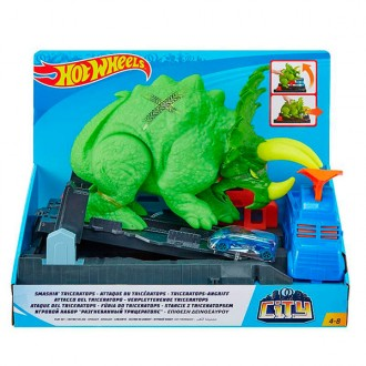 Hot Wheels Pista de coches Ataque del dinosaurio triceratops
